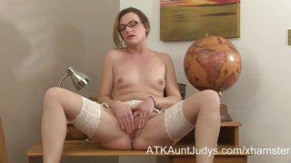 Sexy MILF teacher Sofia Matthews fingers her shaved pussy