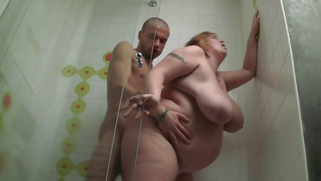 Chubby woman with red hair, alexsis faye is having a shower and rubbing her pussy